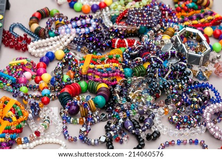 Collection of colourful costume jewelry such as bracelets and necklaces made of glass and plastic beads. . - stock photo