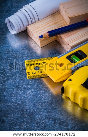 Collection of construction working tools on metallic scratched background architecture and building concept.
