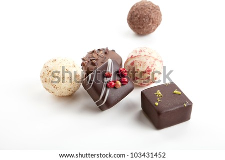 collection of different chocolate pralines isolated - stock photo