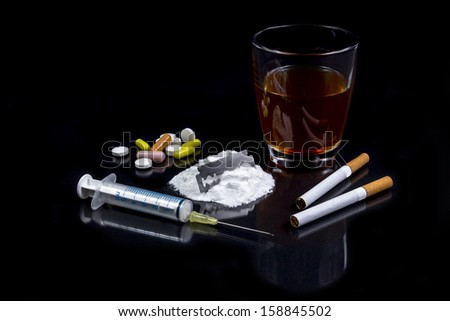 Collection of different hard drugs Heroin, Pills, Tobacco and Alcohol - stock photo