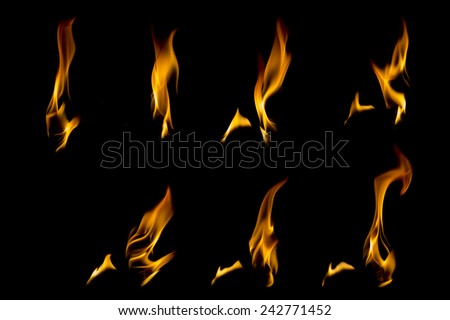 Collection of different types and shapes of flames isolated on black background - stock photo