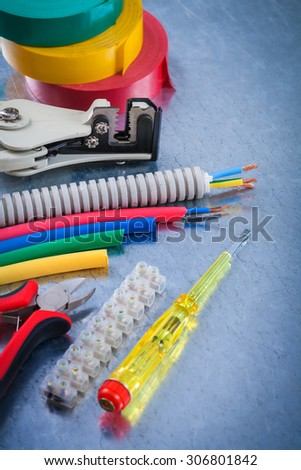 Collection of electrical tools on scratched metallic background construction concept. - stock photo