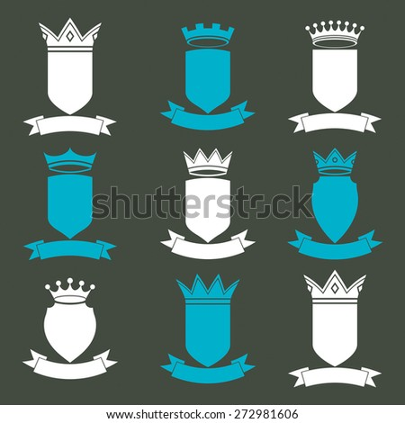 Collection of empire design elements. Heraldic royal coronet illustration. Set of luxury  shields with king crown and undulate festive ribbon.  - stock photo