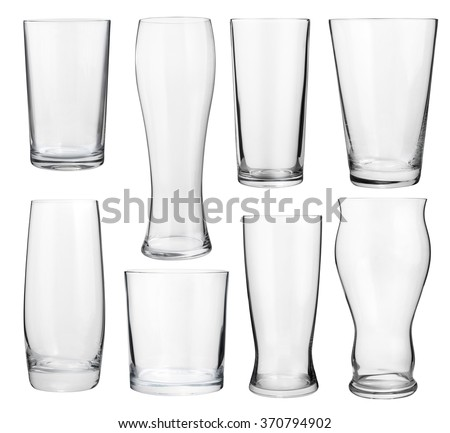 Collection of empty glasses for alcohol and soft drinks - stock photo