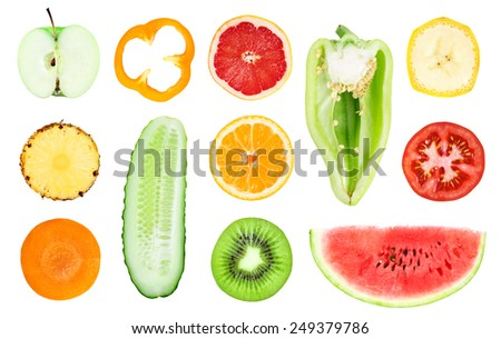 Collection of fresh fruit and vegetable slices on white background - stock photo
