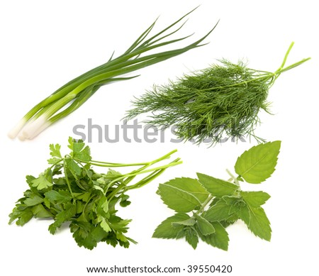 Collection of fresh greens on the white background - stock photo