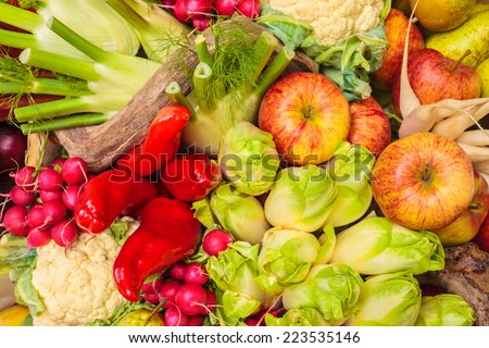 Collection of fresh organic food with apples, bell peppers and other vegetables - stock photo