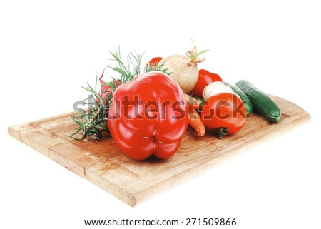 collection of fresh raw vegetables isolated on white background on kitchen wooden board - stock photo