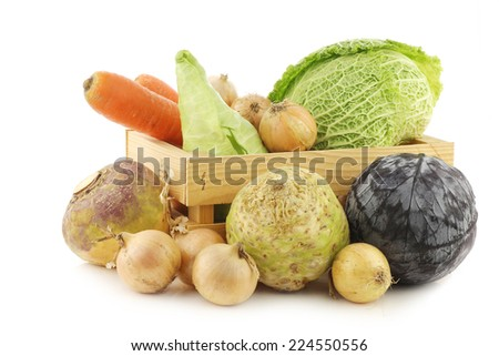 collection of fresh winter vegetables in a wooden crate on a white background - stock photo