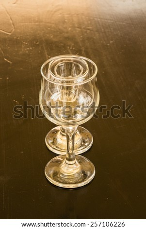 Collection of glasses glasses isolated on a white background , on a black background on the table - stock photo