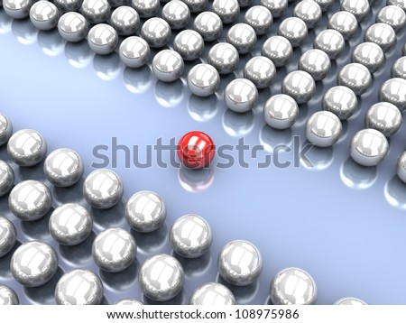 Collection of glossy grey balls with red ball in the middle - stock photo
