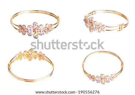 Collection Of Gold Bracelet Isolated On White - stock photo