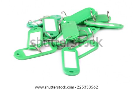 collection of green key fobs on a white background