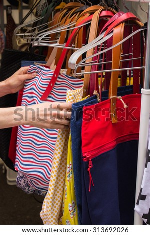 Collection of handmade handbags on stall at the bazaar, womanly accessories - stock photo