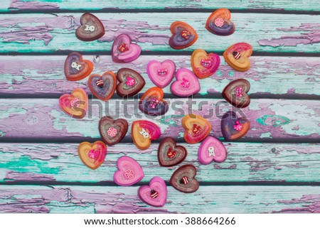 Collection of heart shaped homemade soaps on a wooden background. Also available in vertical format.   - stock photo