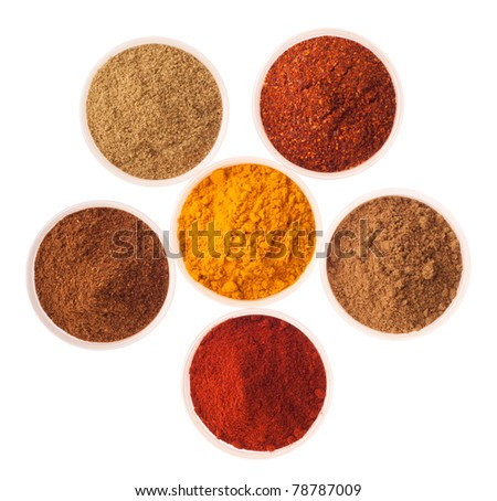 collection of indian spices (cumin, coriander, paprika, garam masala, curcuma, red pepper flakes) on glass cups isolated on white background - stock photo