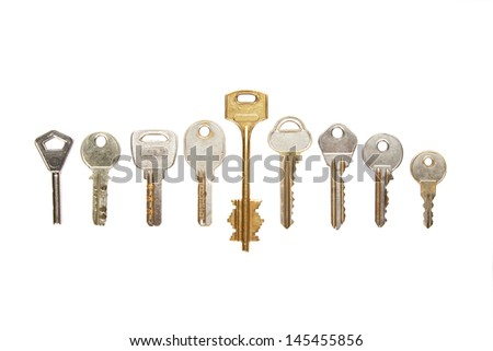 Collection of keys on white background - stock photo