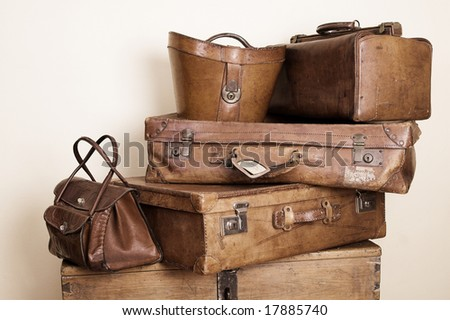 Collection of leather suitcases and bags stacked - stock photo