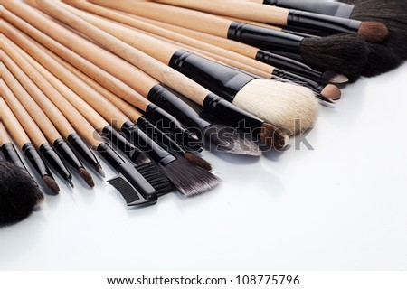 Collection of make-up brushes on white background - stock photo