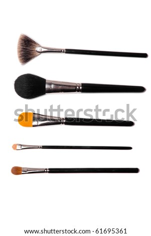 collection of make-up brushes over white - stock photo