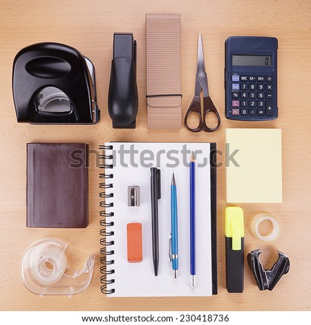 collection of miscellaneous stationery supplies and writing material - stock photo