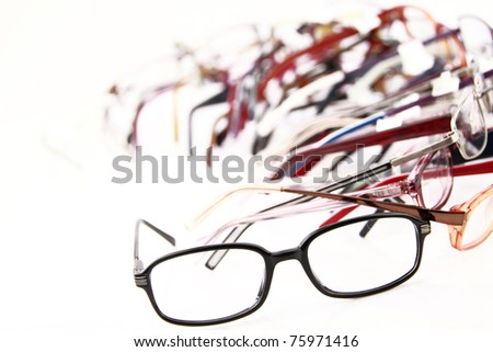 Collection of modern medical eyeglasses - stock photo