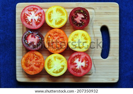 Collection of multicolored tomatoes - stock photo