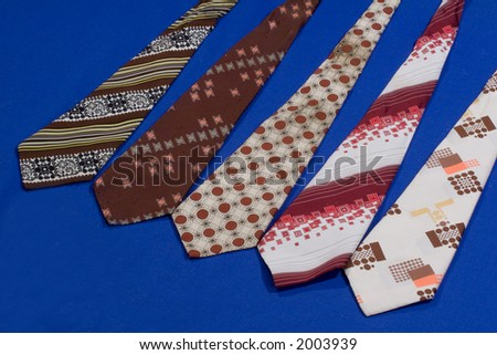 collection of neck ties on blue background - stock photo