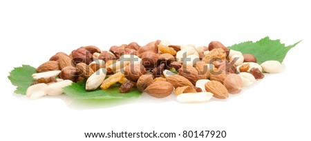 collection of nuts and dried fruits on green fresh leaves isolated on white background - stock photo
