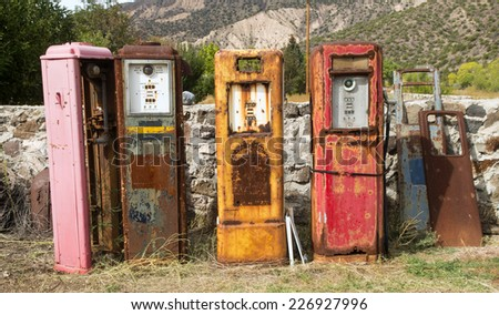 Collection of old rusting gas pumps found in an antique store in New Mexico - stock photo