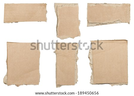 collection of ripped  brown pieces of cardboard, no shadows, isolated on white.
