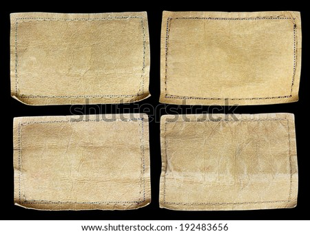 collection of various jeans labels on black background - stock photo