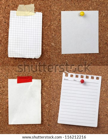 collection of various note papers  on cork board - stock photo