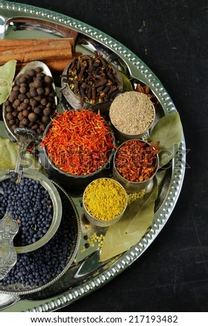 collection of various spices (paprika, turmeric, pepper, aniseed, cinnamon, saffron) - stock photo