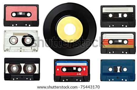 collection of various vintage audio tapes and a vinyl disc on white background. each one is shot separately - stock photo