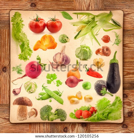 Collection of vegetables on grunge yellow paper and wooden background