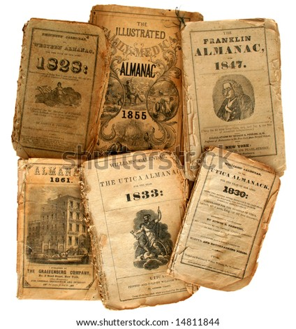 Collection of very old farmer's almanacs - stock photo