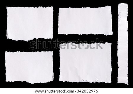 Collection of white ripped pieces of paper on black background - stock photo