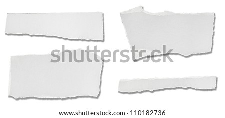 collection of  white ripped pieces of paper on white background