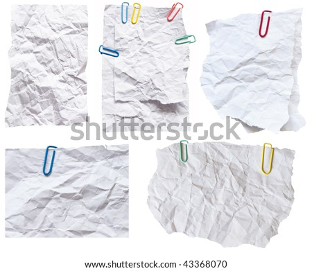 collection of wrinkled paper notes with colorful clips - stock photo