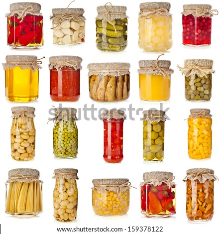 Collection set of many homemade glass bottles with preserved food close up isolated on white background - stock photo