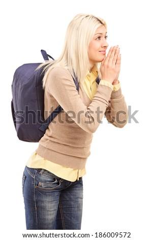 College girl eagerly anticipating something isolated on white background - stock photo