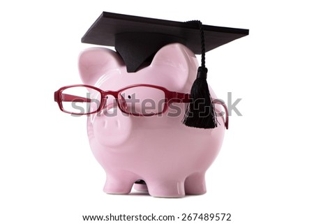 College graduate, education cost concept, piggy bank isolated - stock photo