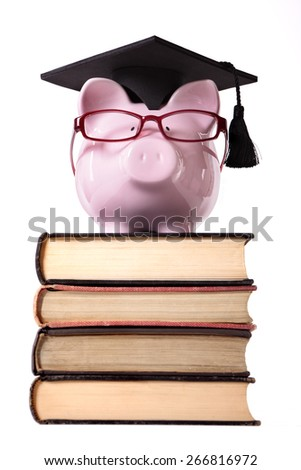College graduate student piggy bank vertical - stock photo