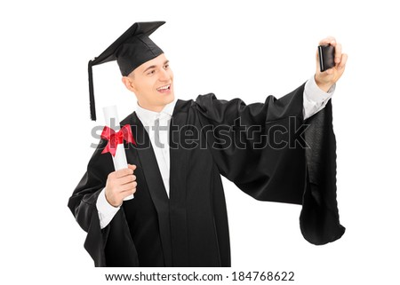 College graduate taking a selfie with cell phone holding a diploma isolated on white background - stock photo