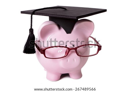 College graduation, education fund concept, piggy bank - stock photo