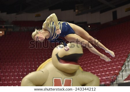 COLLEGE PARK, MD - JANUARY 9: WVU gymnast Melissa Idell performs on the balance beam during a meet January 9, 2015 in College Park, MD.
