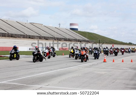 COLLEGE STATION, TX - APRIL 10: Racers leave the starting grid in the six-hour endurance race for super bikes at Texas World Speedway April 10, 2010 in College Station, TX - stock photo