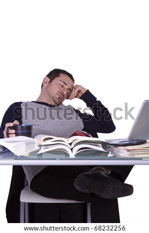 College Student Falling Asleep while Studying for his Finals - Isolated Background