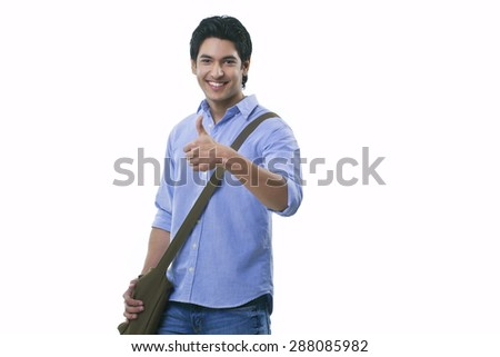 College student showing thumbs up sign - stock photo